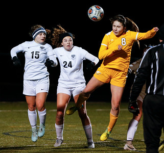 Cecilia Pankau (8) from Jacobs heads a corner kick in front of Jessica Mirsky (15) and Maddie Donnelly (24) from Bartlett during the second half of their game at Millennium Field on Friday, March 16, 2018 in Streamwood, Illinois. John Konstantaras photo for Shaw Media