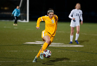 Andie Voss (9) from Jacobs takes the ball across the field during the first half of their game against Bartlett at Millennium Field on Friday, March 16, 2018 in Streamwood, Illinois. John Konstantaras photo for Shaw Media