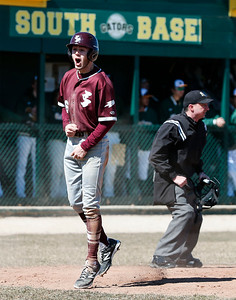 Robbie Copenharve (16) from Richmond-Burton reacts after scoring on a suicide squeeze bunt by Connor Donohoe (20) from Richmond-Burton during the sixth inning of their game at Crystal Lake South on Saturday, March 17, 2018 in Crystal Lake, Illinois. The Gators won the game 6-5 in nine innings. John Konstantaras photo for Shaw Media