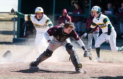 Steven Siavelis (14, left) from Crystal Lake South scores and reacts as Brandon Bannon (7) from Richmond-Burton grabs the ball during the ninth inning of their game at Crystal Lake South on Saturday, March 17, 2018 in Crystal Lake, Illinois. The Gators won the game 6-5 in extra innings. John Konstantaras photo for Shaw Media