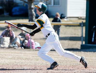 Blake Kuffel (7) from Crystal Lake South hits a walk off single in the ninth inning of their game against Richmond-Burton at Crystal Lake South on Saturday, March 17, 2018 in Crystal Lake, Illinois. The Gators won the game 6-5 in extra innings. John Konstantaras photo for Shaw Media