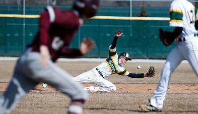 Benjamin Peltz (17) from Crystal Lake South cannot get a to an RBI hit by Matt Eskuri (10) from Richmond-Burton during the first inning of their game at Crystal Lake South on Saturday, March 17, 2018 in Crystal Lake, Illinois. The Gators won the game 6-5 in extra innings. John Konstantaras photo for Shaw Media
