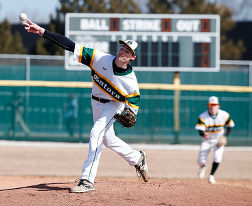 Kyle Lang (12) from Crystal Lake South delivers a pitch during the first inning of their game against Richmond-Burton at Crystal Lake South on Saturday, March 17, 2018 in Crystal Lake, Illinois. The Gators won the game 6-5 in extra innings. John Konstantaras photo for Shaw Media