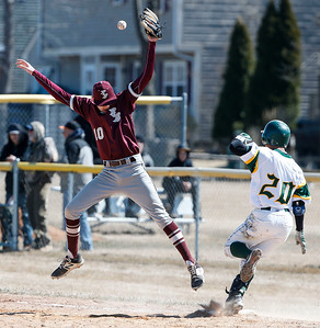 Beiker W. Fuentes Reyes (20) from Crystal Lake South reaches first on a lead off bunt as Matt Eskuri (10) from Richmond-Burton misses the throw during the sixth inning of their game at Crystal Lake South on Saturday, March 17, 2018 in Crystal Lake, Illinois. The Gators won the game 6-5 in nine innings. John Konstantaras photo for Shaw Media