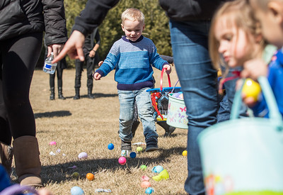 Whitney Rupp for Shaw Media Christian Dexter, 3, Lakewood, runs to pick up eggs at Living Waters Lutheran Church during the church's annual Easter Egg Hunt Sunday, March 18.