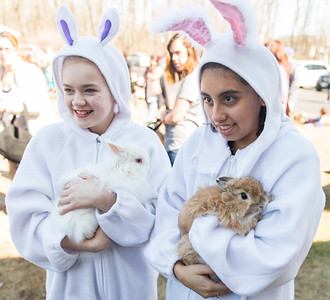 Whitney Rupp for Shaw Media Jessi Williams, left, 12, Cary, and Madalynn Emberton, 16, Lake in the Hills, carry bunnies at Living Waters Lutheran Church Sunday, March 18 during the annual Easter Egg Hunt.