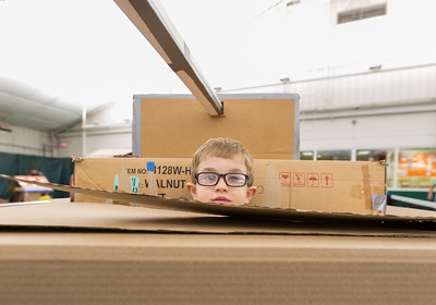 Whitney Rupp for Shaw Media Evan Niziolek, 6, Crystal Lake, peers out of his family's cardboard tank Saturday, March 17.