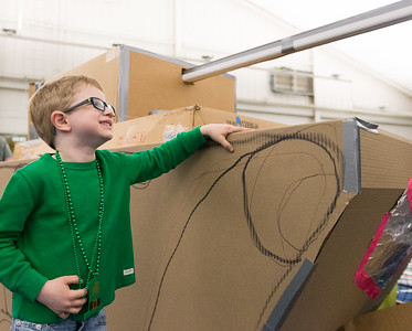 Whitney Rupp for Shaw Media Evan Niziolek, 6, Crystal Lake, stands with his family's cardboard tank Saturday, March 17.