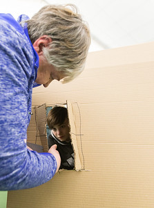 Whitney Rupp for Shaw Media4 Sharlene Biancalana, Chicago, cuts a window into a cardboard fort wall as grandson Sean Raadsen, 11, Crystal Lake, watches. The Crystal Lake Park District hosted 'Forts on the Courts' at The Racket Club in Algonquin Saturday, March 17.