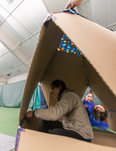 Whitney Rupp for Shaw Media Ariel Levitt, Crystal Lake, sits inside of a cardboard fort Saturday, March, 17 at Crystal Lake Park District's 'Forts on the Courts.'