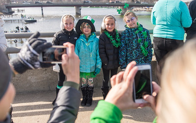 Whitney Rupp for Shaw Media A young group of friends and sisters pose for their mothers during the city of McHenry's St. Patrick's Day celebration Saturday, March 17. Pictured, from left, are Juliana Piotrowicz, 7, Kiera Kukla, 6, Jovanna Piotrowicz, 7, Khloe Kukla, 8, from McHenry.