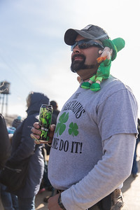 Whitney Rupp for Shaw Media Vincent Hohol, McHenry, celebrates St. Patrick's Day on the Pearl Street Bridge in McHenry during the city's inaugural dyeing of the Fox River Saturday, March 17.