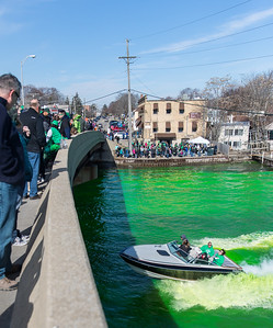 Whitney Rupp for Shaw Media A group of boaters drives under the Pearl Street Bridge Saturday, March 17 after the river was dyed green to celebrate St. Patrick's Day.