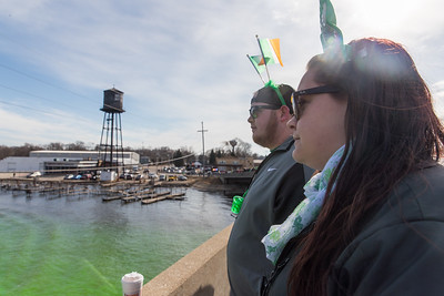 Whitney Rupp for Shaw Media Jason Jett and Brenda Liewald of Hebron stand on the Pearl Street Bridge the morning of St. Patrick's Day.