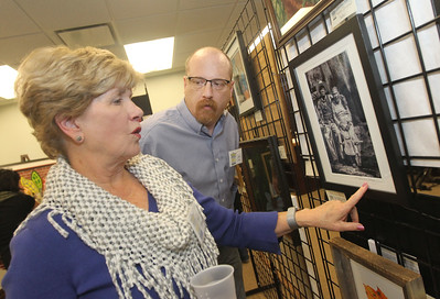 "Candace H. Johnson-For Shaw Media Patricia Solano, of Vernon Hills talks with Jeff Foy, of Grayslake about a photo she had on display of a couple she photographed in Mexico titled, ""El Matrimonio,"" during the Grayslake Arts Alliance Fine Art Show to highlight the Illinois Bicentennial Celebration at the Grayslake Heritage Center & Museum on Hawley Street in Grayslake.(3/17/18)"