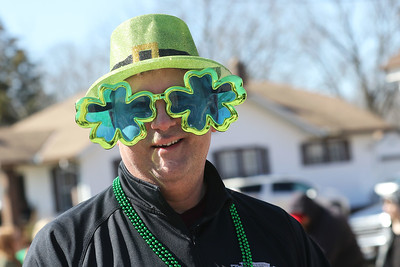 Candace H. Johnson-For Shaw Media Jerry Wetter, of Lindenhurst wears shamrock glasses as he walks in the parade handing out candy for the Community Trust Credit Union during the Village of Lake Villa's Annual St. Patrick's Day Parade on Cedar Avenue in Lake Villa.(3/17/18)