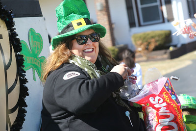 Candace H. Johnson-For Shaw Media Sandiey Massarelli, of Antioch throws candy to the crowd as she rides in the Lawn Doctor's float, a family business, during the Village of Lake Villa's Annual St. Patrick's Day Parade on Cedar Avenue in Lake Villa.(3/17/18)
