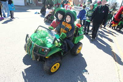 Candace H. Johnson-For Shaw Media Mark Hedsund, of Lake Villa and his twin brother, Erik, both 4, drive down Cedar Avenue in a John Deere toy tractor during the Village of Lake Villa's Annual St. Patrick's Day Parade on Cedar Avenue in Lake Villa.The brothers were in the parade with a group from the Prince of Peace Catholic Church & School.(3/17/18)