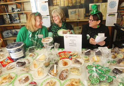 Candace H. Johnson-For Shaw Media Paula Cournoyer, of Round Lake Beach, Penny O'Brien and Rosa Wisler, both of Lake Villa sell desserts for the Desserts for Donations Fundraiser during the corned beef and cabbage luncheon hosted by the Village of Lake Villa at the Lake Villa VFW Post 4308 after the annual St. Patrick's Day Parade on Cedar Avenue in Lake Villa.The Desserts for Donations money raised will go towards veterans support.(3/17/18)