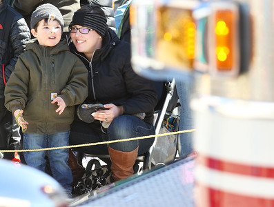 Candace H. Johnson-For Shaw Media Jesse Beyer, 3, of Lake Villa and his mother, Tifffany, watch the firetrucks go by during the Village of Lake Villa's Annual St. Patrick's Day Parade on Cedar Avenue in Lake Villa.(3/17/18)