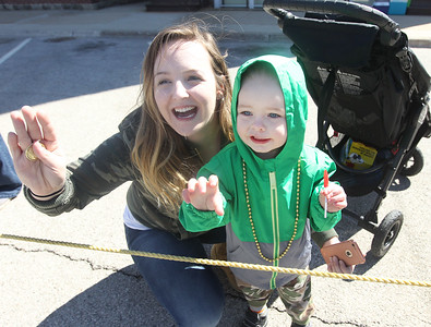 Candace H. Johnson-For Shaw Media Ashley Stritter, of Gurnee and her son, Jensen, 2, wave to the Grayslake 2017 queens during the Village of Lake Villa's Annual St. Patrick's Day Parade on Cedar Avenue in Lake Villa.(3/17/18)