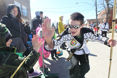 Candace H. Johnson-For Shaw Media Scott Abbinanti, 14, of Lake Villa high-fives kids as he walks in the parade with the Lake Villa Flying Dragons martial arts school during the Village of Lake Villa's Annual St. Patrick's Day Parade on Cedar Avenue in Lake Villa.(3/17/18)