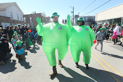 Candace H. Johnson-For Shaw Media T.J.Weber, of Lake Villa and Kevin Wooten, of Grayslake walk in green costumes to promote T.J.'s father, Tom Weber, as he is runs for State Representative, during the Village of Lake Villa's Annual St. Patrick's Day Parade on Cedar Avenue in Lake Villa.(3/17/18)