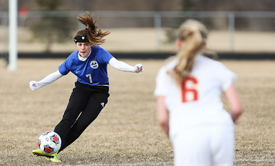 Whitney Rupp for Shaw Media Korrin Mecklenburg of Woodstock passes the ball against Richmond-Burton Tuesday, March 20.