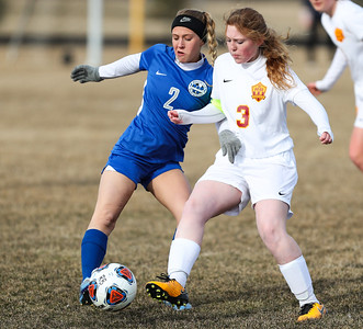 Whitney Rupp for Shaw Media Camryn Tafoya of Woodstock and Madeline Harrah of Richmond-Burton fight for control of the ball Tuesday, March 20.