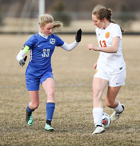 Whitney Rupp for Shaw Media Woodstock's Cameron Wormley looks to get control of the ball over Richmond-Burton's Leigha Denzel Wednesday, March 20.