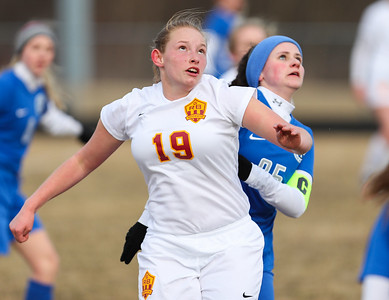 Whitney Rupp for Shaw Media Richmond-Burton's Mae Luce and Woodstock's Grace Maidment watch the ball during Tuesday's game. The Rockets defeated the Blue Streaks 1-0.