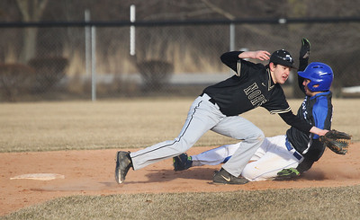 Candace H. Johnson-For Shaw Media Grayslake North's Sebastian Sancen waits for the throw as Warren's Casey Cobe slides past him to second base in the fifth inning at Warren Township High School in Gurnee. Warren won 5-1.(3/19/18)