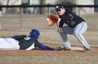 Candace H. Johnson-For Shaw Media Warren's Sam Deluca slides safely back to first during a pickoff attempt as Grayslake North's Lane Getka waits for the throw in the fourth quarter at Warren Township High School in Gurnee. Warren won 5-1.(3/19/18)