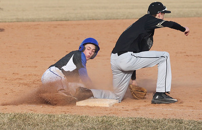 Candace H. Johnson-For Shaw Media Warren's Riley Kocen slides safely to third before the tag by Grayslake North's Matt Heery in the fourth inning at Warren Township High School in Gurnee.Warren won 5-1.(3/19/18)