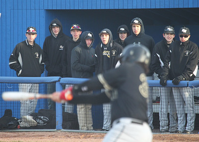 Candace H. Johnson-For Shaw Media Players from the Grayslake North baseball team watch Austin Delao connect on a pitch against Warren in the sixth inning at Warren Township High School in Gurnee. Warren won 5-1.(3/19/18)