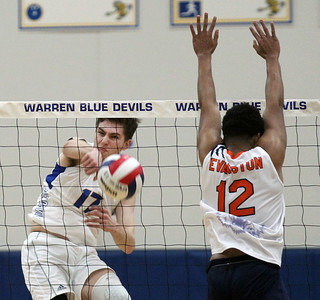 Candace H. Johnson-For Shaw Media Warren's Kyle Wells makes an attack as Evanston's Chyne Temple puts up the block in the second set at Warren Township High School in Gurnee. Warren won (25-11), (25-10).(3/19/18)
