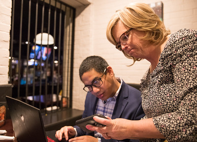 Whitney Rupp for Shaw Media  Candidate for the 22nd Judicial Circuit Judge Tiffany Davis checks her phone on election night while campaing website designer Abe Levy searches for results at Woodstock Public House Tuesday, March 20.