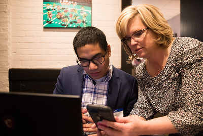 Whitney Rupp for Shaw Media Candidate for the 22nd Judicial Circuit Judge Tiffany Davis looks at polling results with her website designer Abe Levy at Woodstock Public House Tuesday, March 20.