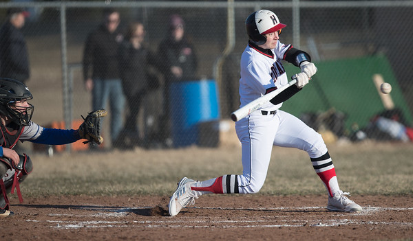 Whitney Rupp for Shaw Media Christopher Constantino of Huntley swings in the third inning against Woodstock Wednesday, March 21.
