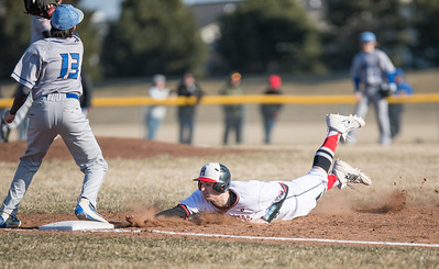 Whitney Rupp for Shaw Media Hunter Rumachik of Huntley slides after trying for a steal against Woodstock's Blake Shallenbarger Wednesday, March 21.
