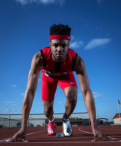Dubem Anikamadu on the track at Huntley High School for a portrait on Thursday, March 22, 2018 in Huntley, Illinois. John Konstantaras photo for Shaw Media