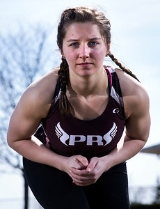 Tasha Schaffer on the track at Prairie Ridge High School for a portrait on Friday, March 23, 2018 in Crystal Lake, Illinois. John Konstantaras photo for Shaw Media