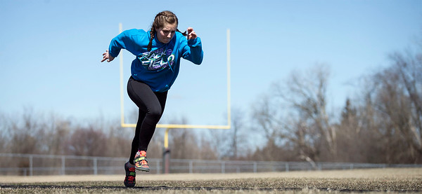 Tasha Schaffer practices triple jump on the track at Prairie Ridge High School on Friday, March 23, 2018 in Crystal Lake, Illinois. John Konstantaras photo for Shaw Media