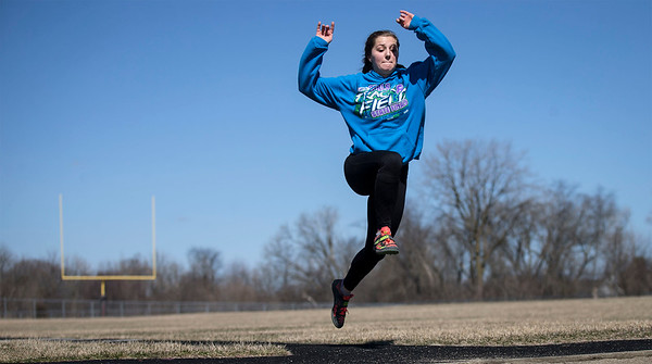 Tasha Schaffer practices triple jump on the track at Prairie Ridge High School on Friday, March 23, 2018 in Crystal Lake, Illinois. John Konstantaras photo for Shaw Media