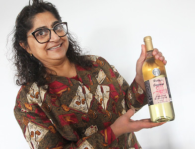"Candace H. Johnson-For Shaw Media Archana ""Ana"" Dave, of Gurnee, owner, holds a bottle of Gingerine, a robust ginger white wine, she makes at the warehouse of Healy's Winery in Lake Villa.(3/26/18)"