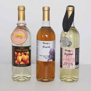 Candace H. Johnson-For Shaw Media Healy's Mango Melody mango wine and Gingerly and Gingerine, both ginger wines, were on display and bottled at Healy's Winery in Lake Villa. Both Mango Melody and Gingerine are award winners.(3/26/18)