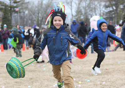 Candace H. Johnson-For Shaw Media Braden Besancon, 6, of Wauconda runs to pick up plastic eggs filled with candy in Cook Park during the Annual Egg Hunt next to the Community Center in Wauconda.The event was sponsored by the Wauconda Park District.(3/24/18)