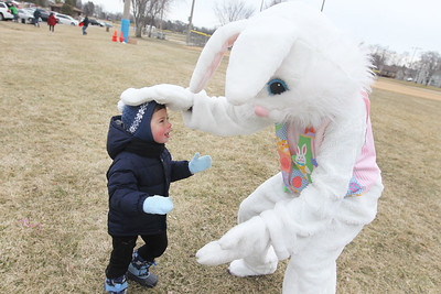 Candace H. Johnson-For Shaw Media Tim Lawitz, 2, of Wauconda visits with the Easter Bunny in Cook Park after the Annual Egg Hunt next to the Community Center in Wauconda. Tim was at the event with his twin sister, Kathy, brothers Andy, 12, and Danny, 8, and parents, Phil and Natalia.The event was sponsored by the Wauconda Park District.(3/24/18)
