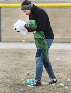 Candace H. Johnson-For Shaw Media Kaylee Bares, 14, of Wauconda drops plastic eggs filled with candy and tickets for prizes in Cook Park for children ages seven to ten-years-old during the Annual Egg Hunt next to the Community Center in Wauconda.The event was sponsored by the Wauconda Park District.(3/24/18)