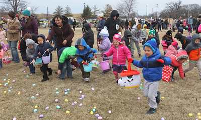 Candace H. Johnson-For Shaw Media Children ages four to six-years-old start running to pick up plastic eggs scattered in Cook Park during the Annual Egg Hunt next to the Community Center in Wauconda.The event was sponsored by the Wauconda Park District.(3/24/18)
